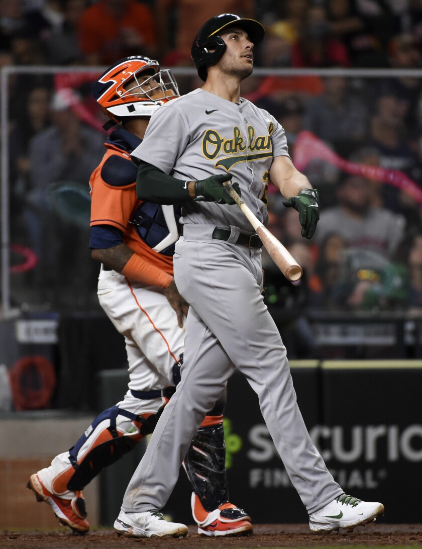 Oakland Athletics' Matt Olson, right, watches his three-run home run during the eighth inning of a baseball game against the Houston Astros, Friday, April 9, 2021, in Houston. (AP Photo/Eric Christian Smith)