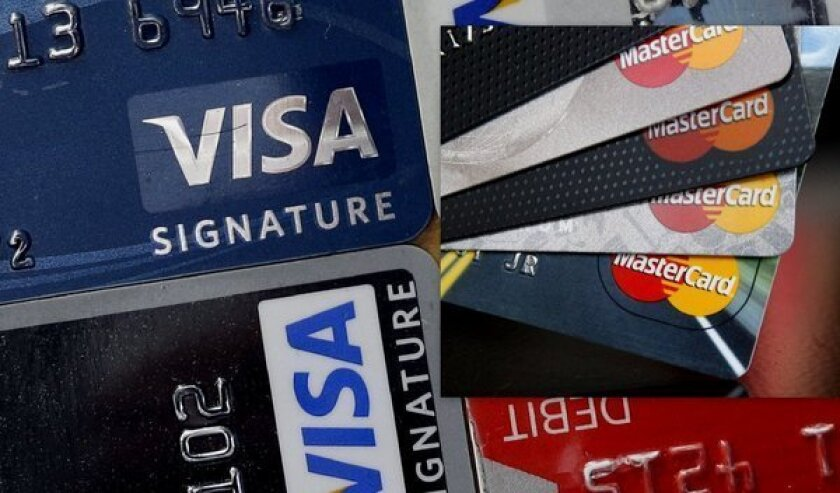 "U.S. credit card companies are beginning to offer ""smart"" credit cards--that is, cards with the chips used by many foreign merchants."