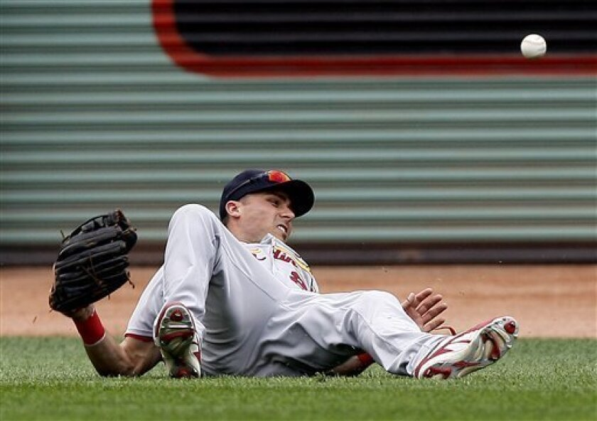 St. Louis Cardinals center fielder Rick Ankiel falls down after failing to get to a triple by Boston Red Sox's Coco Crisp during the eighth inning of a baseball game at Fenway Park in Boston, Sunday, June 22, 2008. (AP Photo/Winslow Townson)