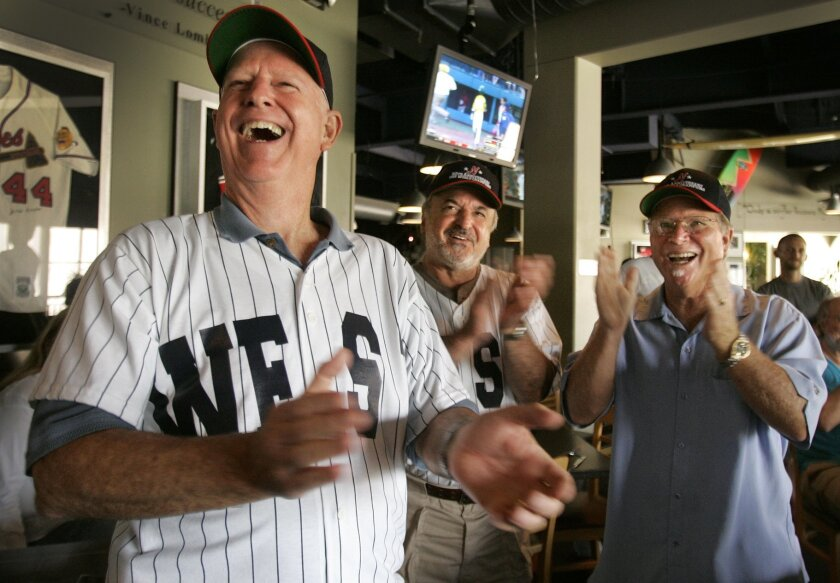Members of the 1961 Little League Champions from East County, Jim Dolan (left) Mike Salvatore (center) and Steve Jupin cheer at their 50th anniversary reunion at Seau's The Restaurant. Howard Lipin • U-T