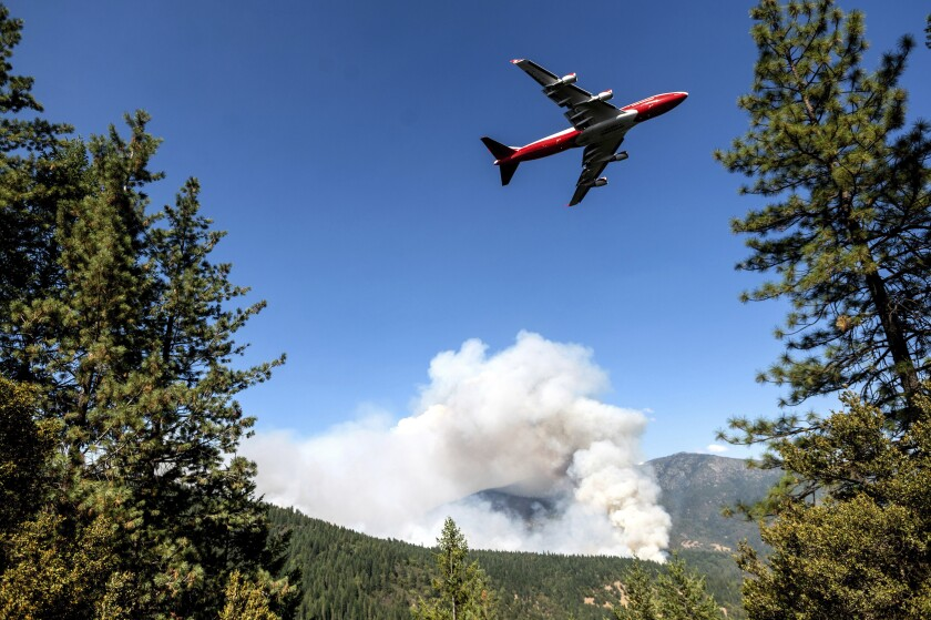 An air tanker prepares to drop retardant while battling the August Complex fire in the Mendocino National Forest.