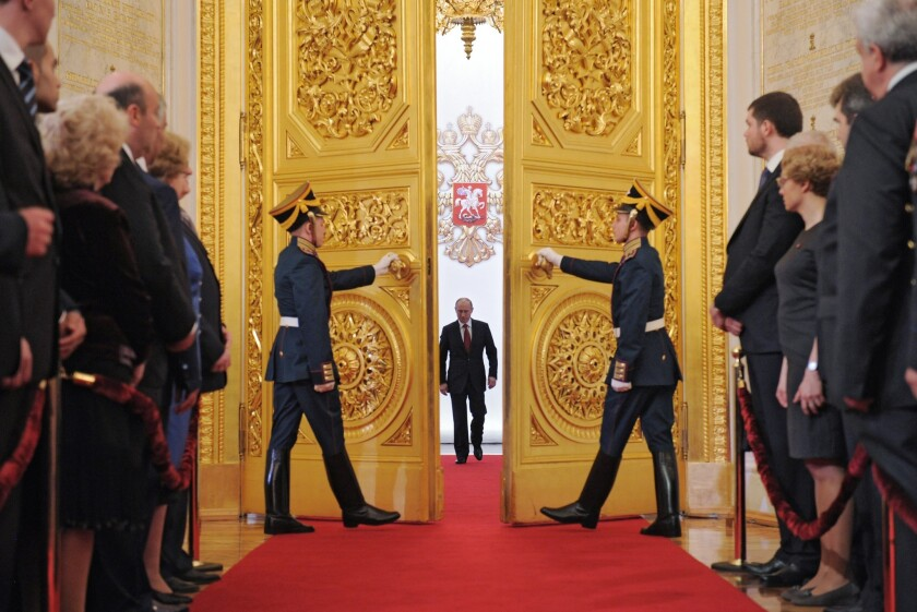 Russia's President Vladimir Putin (C) enters Andreyevsky (St.Andrew's ) Hall at the Great Kremlin Pa