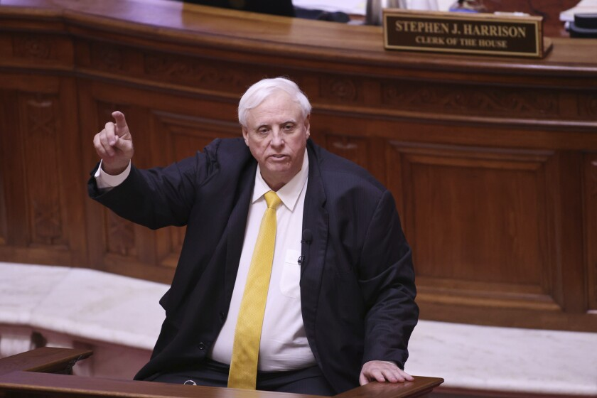 FILE - West Virginia Gov. Jim Justice speaks during the State of the State Address in the House Chambers of the West Virginia State Capitol Building in Charleston, W.Va., on Wednesday, Feb. 10, 2021. Justice has agreed to live in the seat of state government in Charleston, ending a long-running challenge over his residency. A Kanawha County judge signed an order Monday, March 1, 2021, dismissing a 2018 lawsuit filed by a former state lawmaker. (AP Photo/Chris Jackson, file)