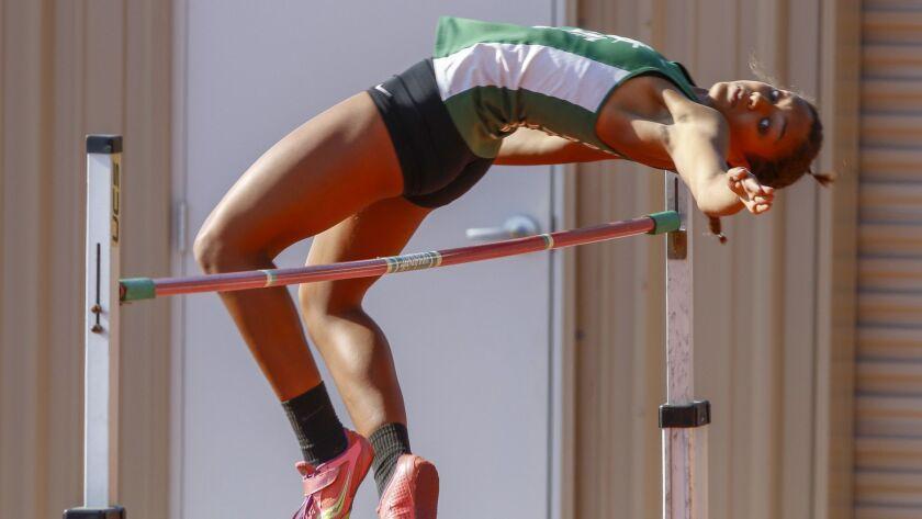 "Coronado's Alysah Hickey clears 5'7"" to win the girls high jump at the Escondido Invitational on Fri"