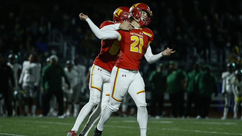 Cathedral Catholic kicker Dean Janikowski (21) cheers his game-winning field goal against Narbonne.