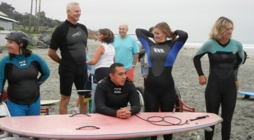 Christopher Montera, in front, participates in the Naval Medical Center San Diego's therapeutic surf clinic. Courtesy photo