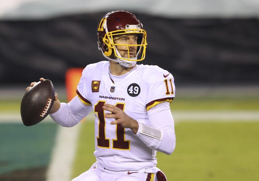 Washington quarterback Alex Smith looks to pass against the Philadelphia Eagles on Jan. 3.