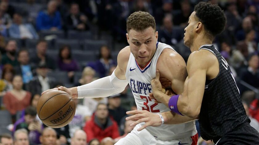 Clippers forward Blake Griffin, left, goes to the basket against Sacramento Kings forward Skal Labissiere during the first quarter on Thursday.