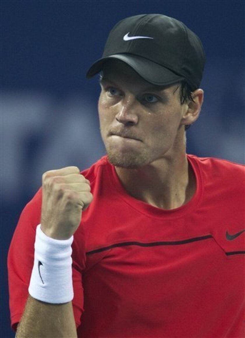 Czech Republic's Tomas Berdych reacts after scoring a point against France's Jo-Wilfried Tsonga during their singles semifinal match of the China Open tennis tournament in Beijing, Saturday, Oct. 8, 2011. (AP Photo/Andy Wong)