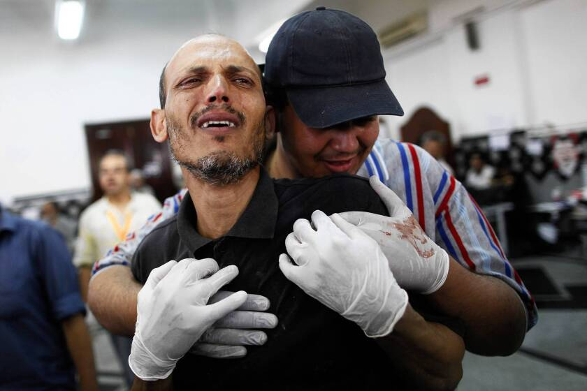 A man grieves at a makeshift hospital in Cairo after the Egyptian military's deadly crackdown on a sit-in by supporters of deposed President Mohamed Morsi.