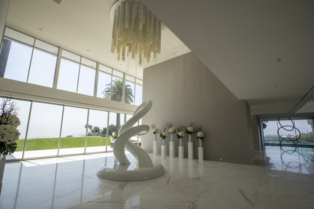 """A view of """"Unity,"""" an 11-foot-tall sculpture in the foyer of The One."""