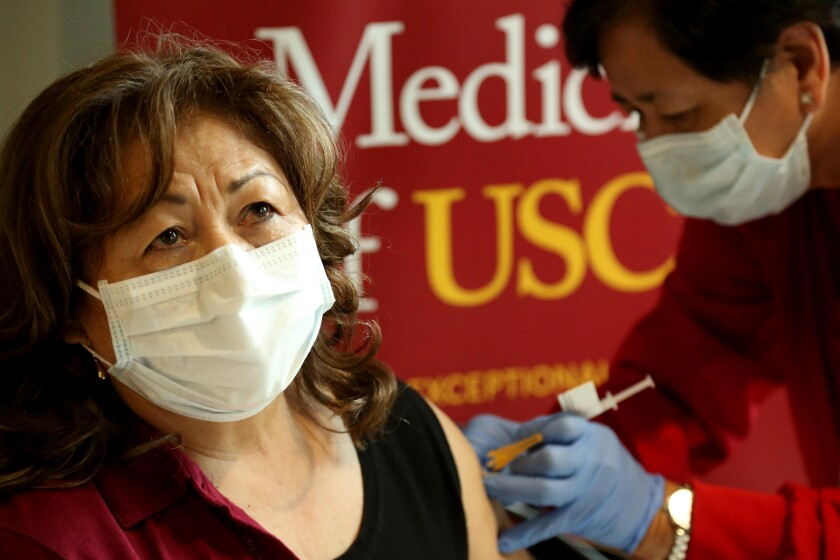 A woman receives a vaccine