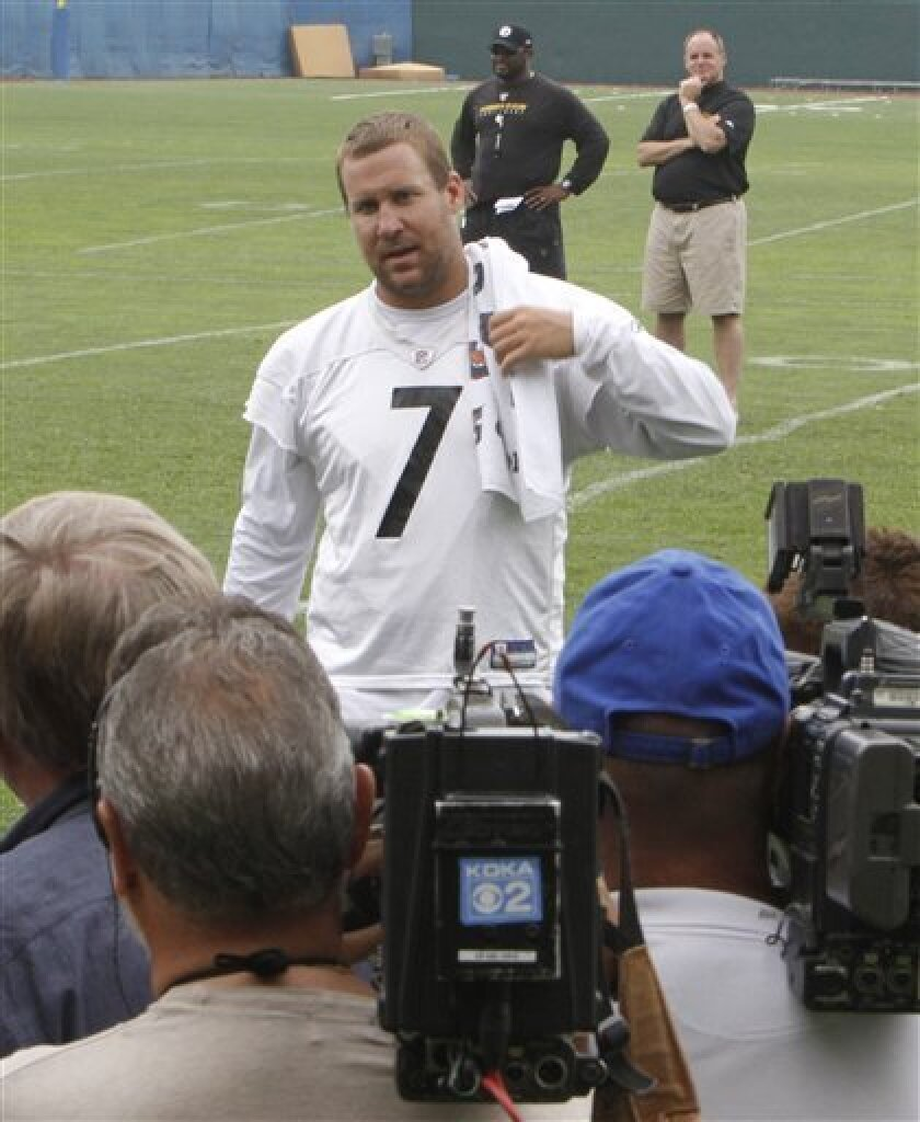 Pittsburgh Steelers quarterback Ben Roethlisberger, center, approaches the gathered media after a practice session at the NFLfootball team's facility in Pittsburgh, Thursday, June 3, 2010. This is the first time Roethlisberger talked with reporters since he has been cleared by the NFL to return to the Steelers for practice and meetings. The quarterback was suspended without pay for six games in the 2010 season by commissioner Roger Goodell after a 20-year-old college student accused him of sexual assault in Milledgeville, Ga. No charges were filed. Steelers coach Mike Tomlin, rear left, and director of football operations , Kevin Colbert, look on.(AP Photo/Keith Srakocic)