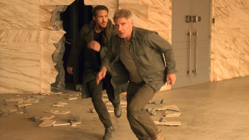 This image released by warner Bros. Pictures shows Ryan Gosling, left, and Harrison Ford in a scene