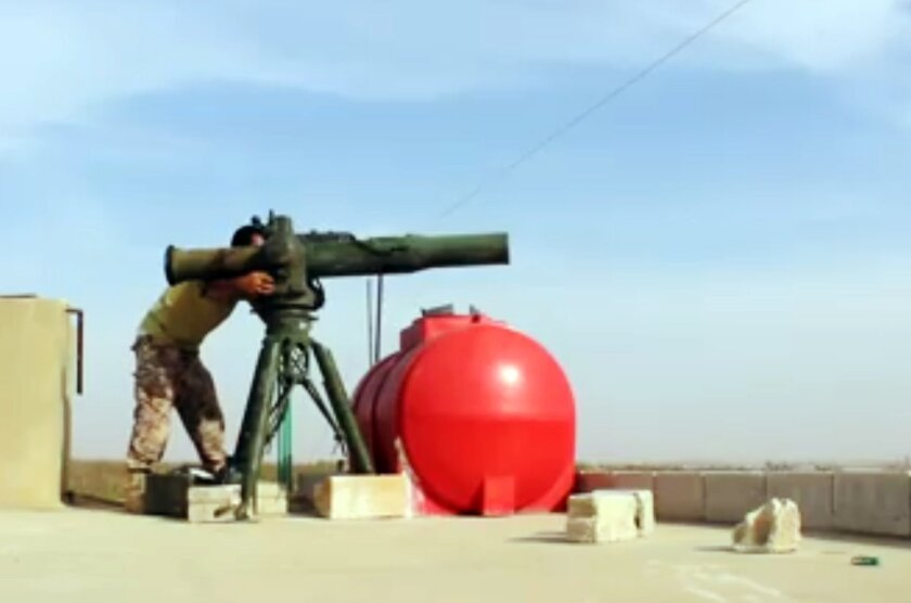 In this photo released on October 18, 2015, and provided by the Fursan al-Haq Syrian rebel brigade, which has been authenticated based on its contents and other AP reporting, a Free Syrian Army fighter of Fursan al-Haq brigade prepares to fire a U.S.-made anti-tank Tow missile, at Skeek village, in