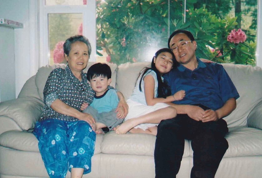 Joseph and Hannah with grandmother Soon Sun and dad Timothy at their home in Washington in 2005.