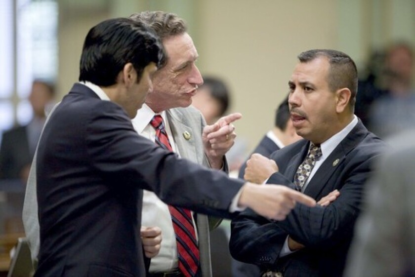 Assemblymen Kevin de Leon (D-Los Angeles), Ira Ruskin (D-Redwood City) and Tony Mendoza (D-Artesia), from left, discuss a bill during Friday's budget deliberations in Sacramento.