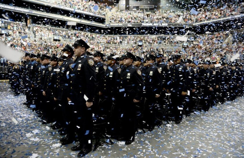 Graduates of the New York Police Department academy at a ceremony in July.