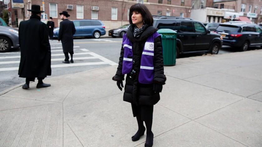 "Ezras Nashim founder Rachel ""Ruchie"" Freier on the streets of Borough Park, Brooklyn. Credit: Nina W"