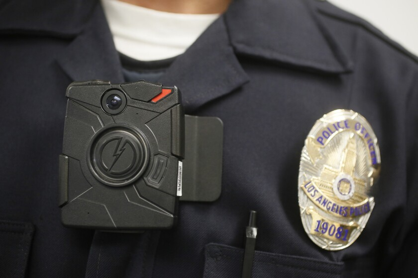 An LAPD officer wears an on-body camera during a demonstration in January of 2014.