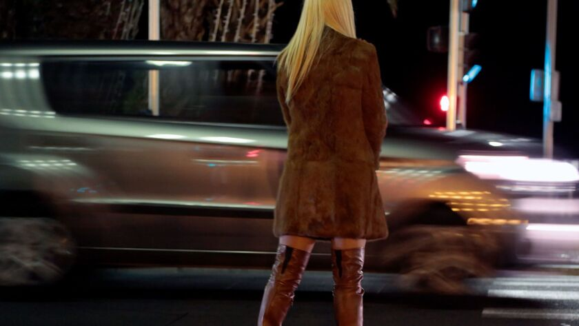 A prostitute from Eastern Europe waits for customers along the Promenade des Anglais in Nice, November 29, 2013.