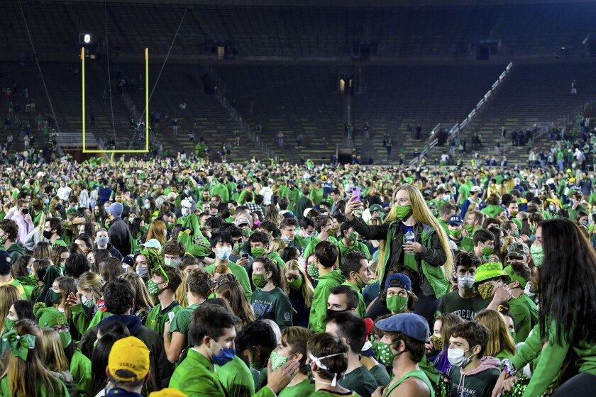 Fans storm the field after Notre Dame defeated Clemson 47-40 in two overtimes Nov. 7, 2020.