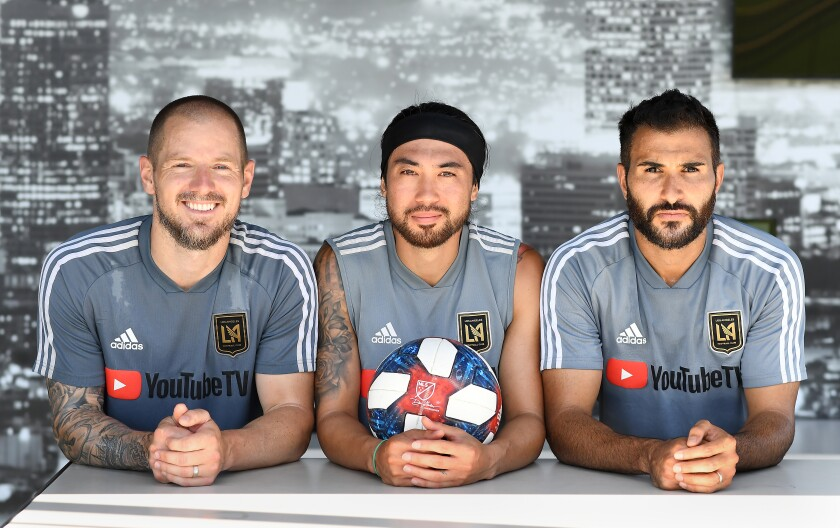 From left, LAFC players Jordan Harvey, Lee Nguyen and Steven Beitashour sport beards and vow not to shave until they win the MLS Cup title.