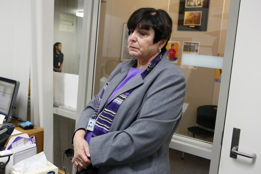 Westside Union School District Supt. Regina Rossall holds back her emotions as she talks about Nigel Hardy, who was found dead in an apparent suicide.