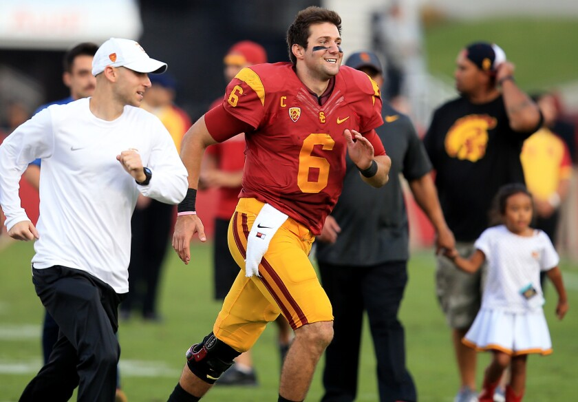 USC quarterback Cody Kessler runs off the field after the Trojans' 49-14 win over Notre Dame on Nov. 29 at the Coliseum.
