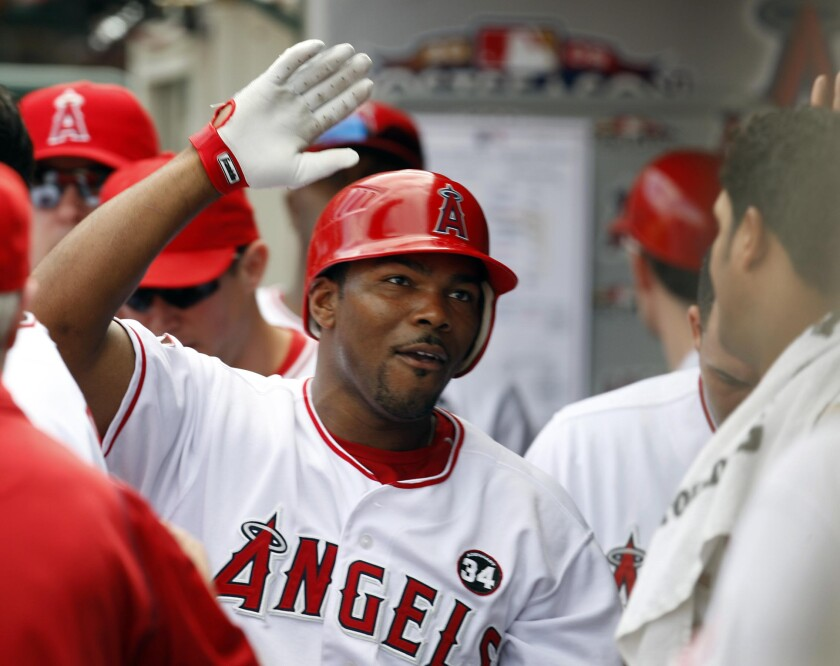 Angels second baseman Howie Kendrick celebrates with teammates after hitting a solo home run against the New York Yankees.