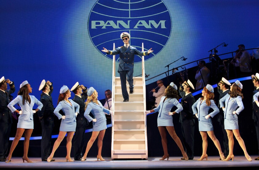 """Stephen Anthony as Frank Abagnale Jr. and the chorus of flight attendants in """"Catch Me If You Can."""" The musical is playing at the Pantages Theatre in Hollywood."""