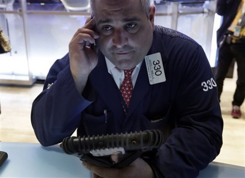 Trader Mario Innella works on the floor of the New York Stock Exchange Wednesday, April 10, 2013. Stocks are opening higher on Wall Street, a day after the Dow Jones industrial average closed at its second all-time high in a week. (AP Photo/Richard Drew)