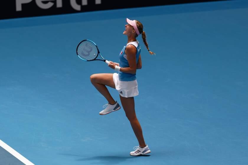 France's Kristina Mladenovic celebrates winning her match against Australia's Ajla Tomljanovic during their Fed Cup tennis final in Perth, Australia, Saturday, Nov. 9, 2019. (AP Photo/Trevor Collens)