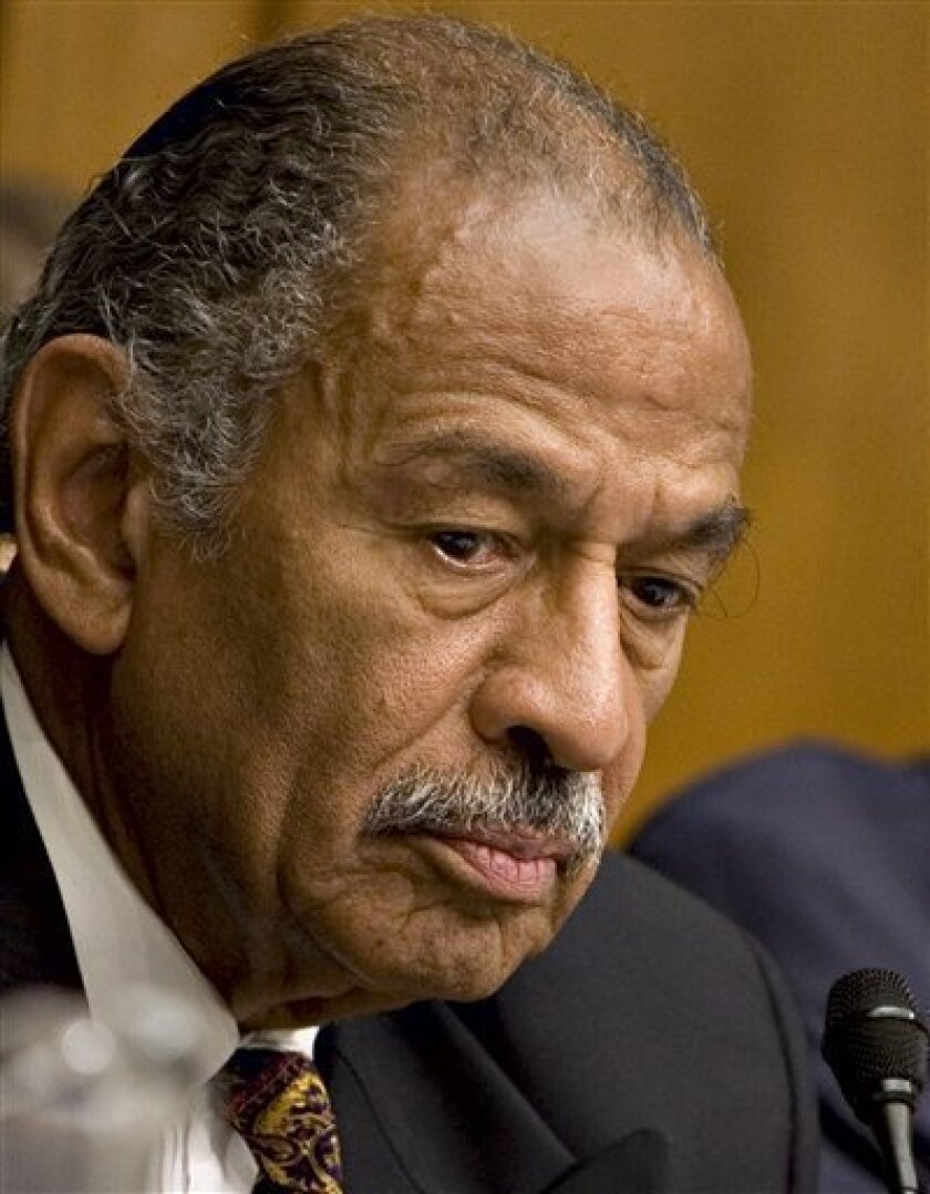 In this July 25, 2008 file photo, House Judiciary Committee Chairman John Conyers, D-Mich., presides over a hearing of the committee on Capitol Hill in Washington. Mere hours before Barack Obama is sworn in as president with a pledge to end the grip of special interests on government, a group of l