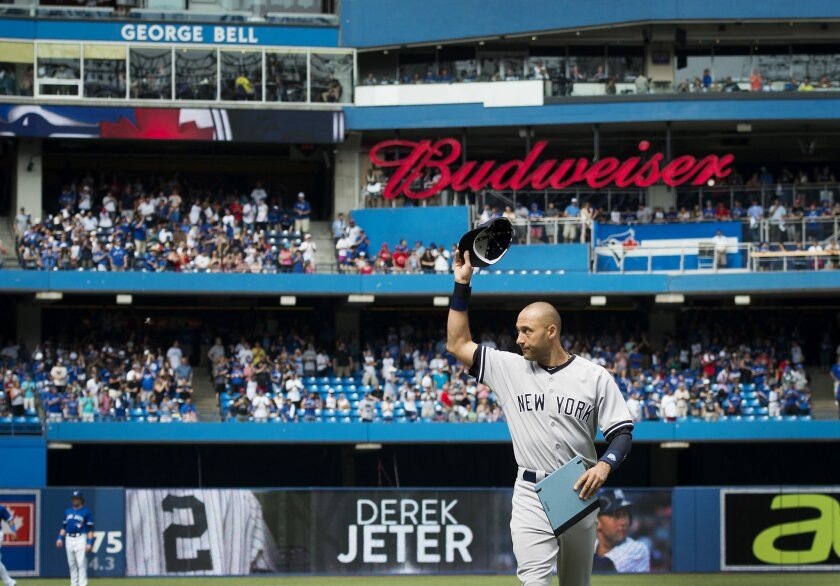 New York Yankees shortstop Derek Jeter acknowledges the crowd while being honored in an on-field ceremony before his final baseball game in Toronto against the Toronto Blue Jays, Sunday, Aug. 31, 2014. (AP Photo/The Canadian Press, Darren Calabrese)