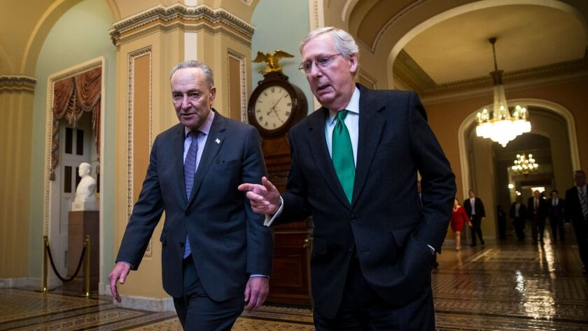 Senate Majority Leader Mitch McConnell (R-Ky.), right, and Senate Minority Leader Chuck Schumer (D-N.Y.) walk to the Senate floor from McConnell's office on Capitol Hill in Washington.