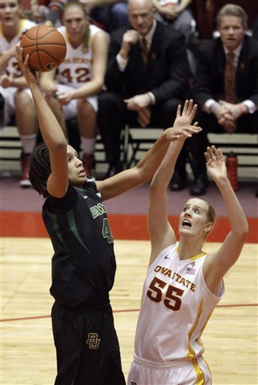 Baylor center Brittney Griner, left, shoots over Iowa State center Anna Prins during the first half of an NCAA college basketball game on Saturday, Jan. 7, 2012, in Ames, Iowa. (AP Photo/Charlie Neibergall)