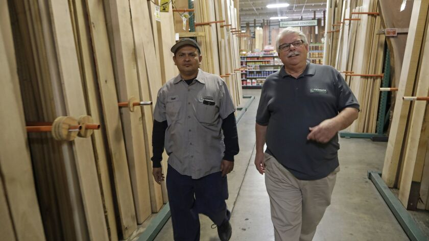 """VAN NUYS, CA -- APRIL 12, 2019: Owner Kevin Kelley, right, and employee David """"Chato"""" Acevedo at Val"""