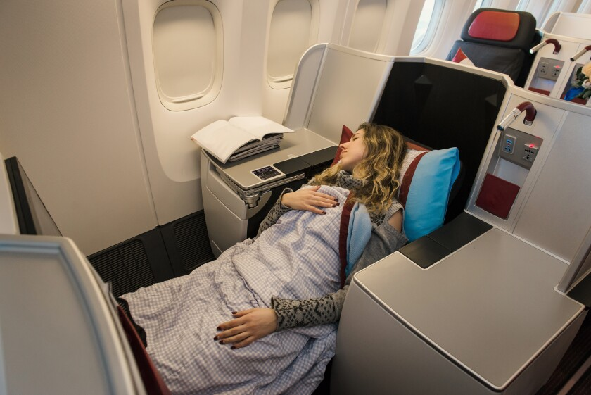 You can snuggle down in a business- or first-class seat without paying a fortune