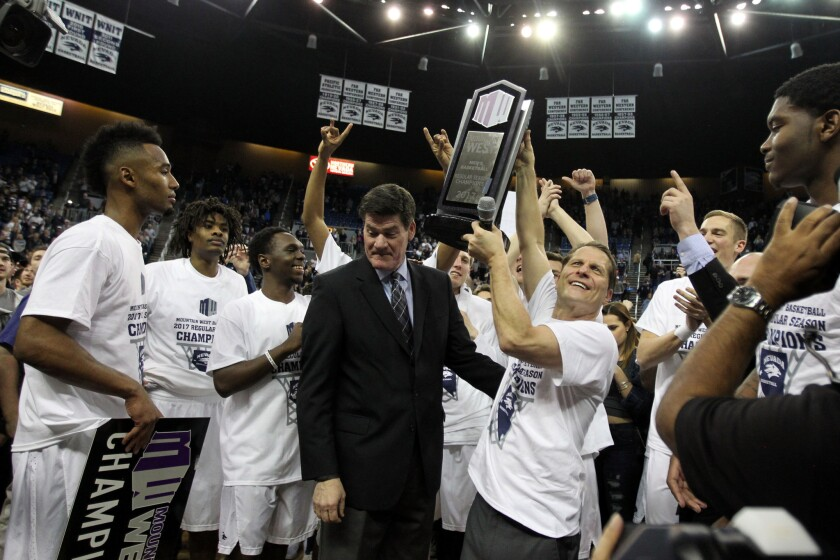 Mountain West commissioner Craig Thompson with the Nevada men's basketball team after winning the regular-season title last Saturday.