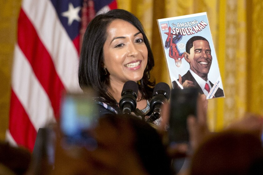 "Ms. Marvel co-creator Sana Amanat holds up an issue of ""The Amazing Spider-Man"" featuring President Obama at a reception for Women's History Month at the White House on March 16."