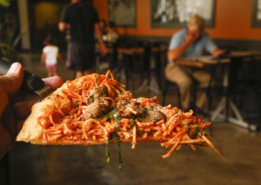 Spaghetti and meatball pizza at Jinny's Pizzeria at The 4th Street Market in Santa Ana