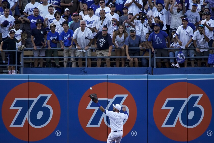 Dodgers left fielder Chris Taylor can't make the catch on a run-scoring double hit by Yankees first baseman Mike Ford during the eighth inning.