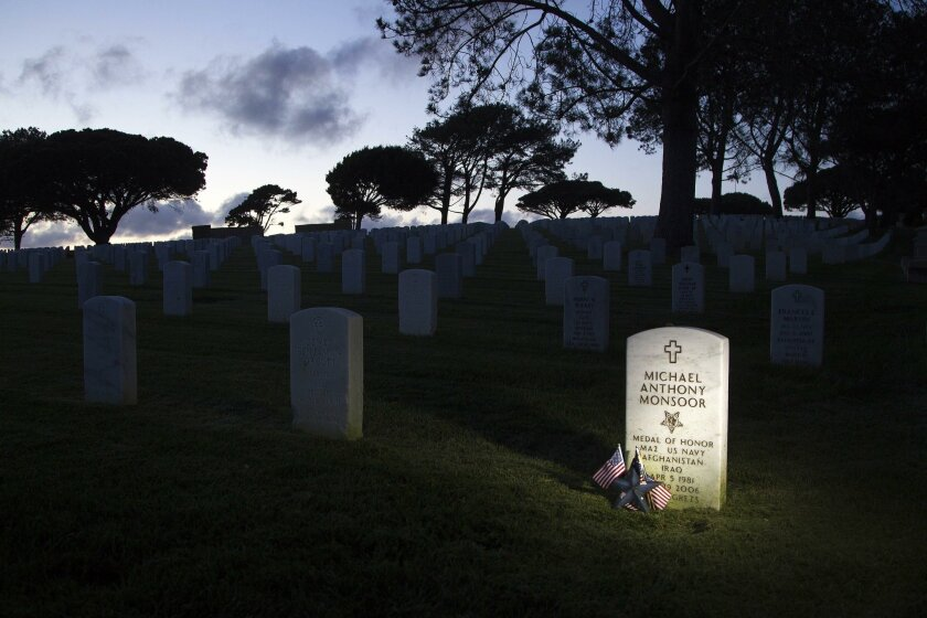 Michael Anthony Monsoor's grave at Fort Rosecrans is constantly being adorned with flowers and keepsakes as many people visit it.