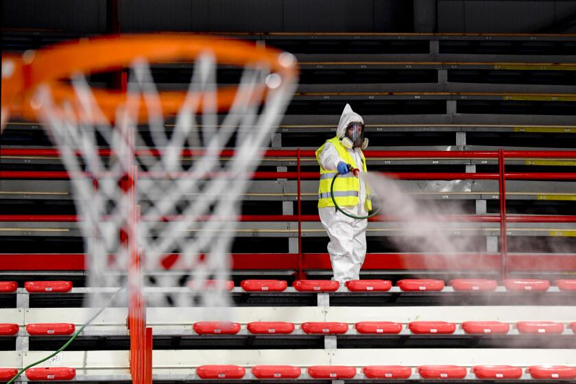 Operators of Naples Services sanitize the sports facility of Palabarbuto to counteract the danger of contagion from coronavirus, Naples, Italy on Tuesday.