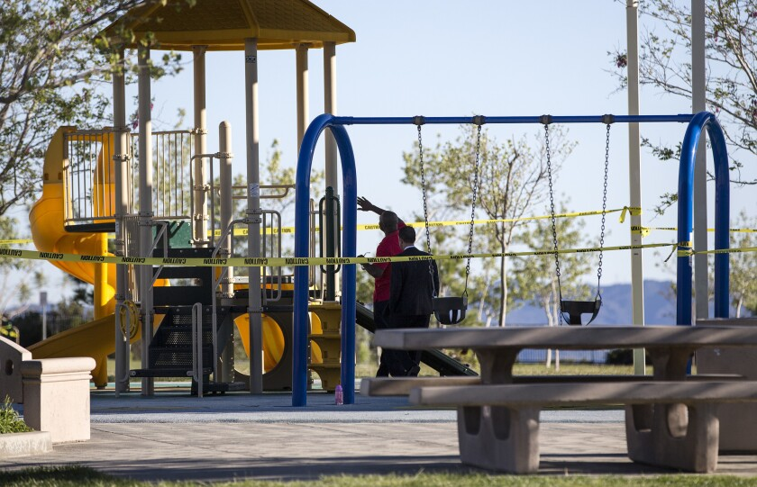 L.A. City Councilman Mitch Englander, right, inspects playground equipment with a park official after Holleigh Bernson Memorial Park was closed because an oily residue was found on the playground in Porter Ranch.