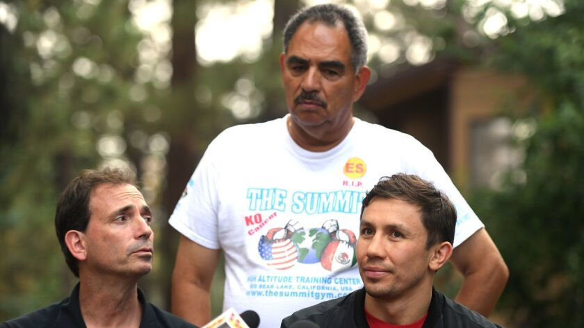 Gennady Golovkin speaks to the media as he is joined by promoter Tom Loeffler, left, and trainer Abel Sanchez, rear, during a press conference at The Summitt on Aug. 9 in Big Bear Lake.