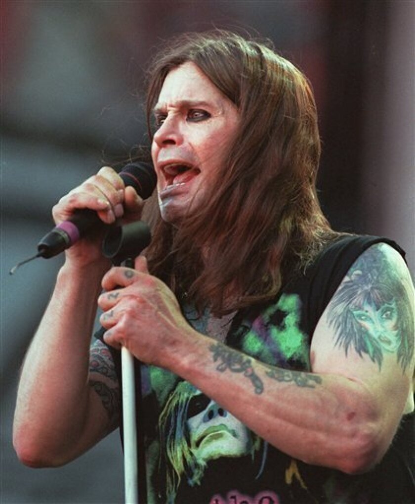 FILE - In this June 15, 1997 file photo, Ozzy Osbourne performs with Black Sabbath during the Ozzfest concert at the Meadowlands in East Rutherford, N.J. (AP Photo/Bill Kostroun, file)