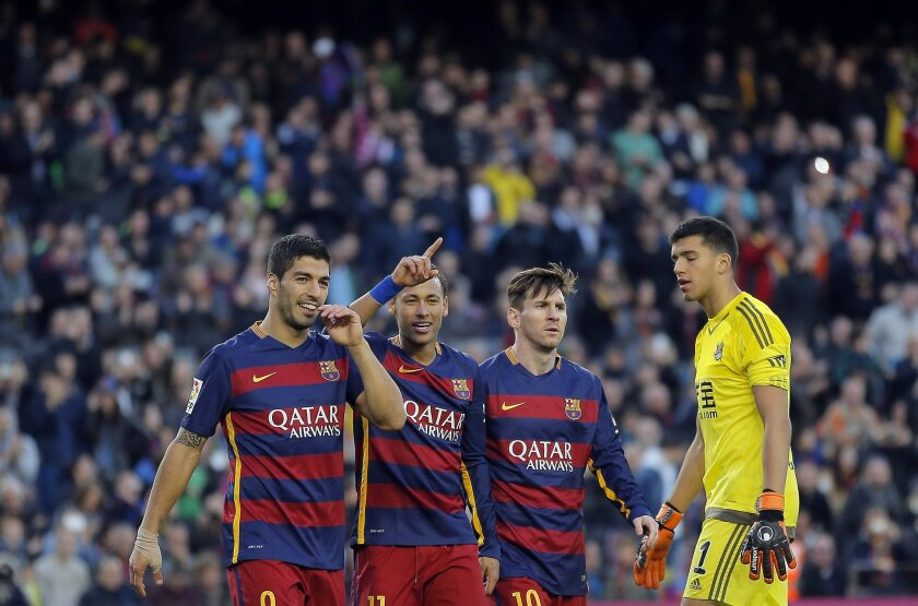 FC Barcelona's Neymar, second left, celebrates with his teammates Luis Suarez, left, and Lionel Messi, second right, after scoring against Real Sociedad during a Spanish La Liga soccer match at the Camp Nou stadium in Barcelona, Spain, Saturday, Nov. 28, 2015. (AP Photo/Manu Fernandez)