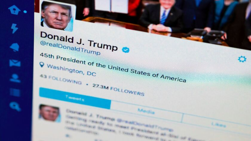 FILE- This April 3, 2017, photo shows President Donald Trump's tweeter feed on a computer screen in
